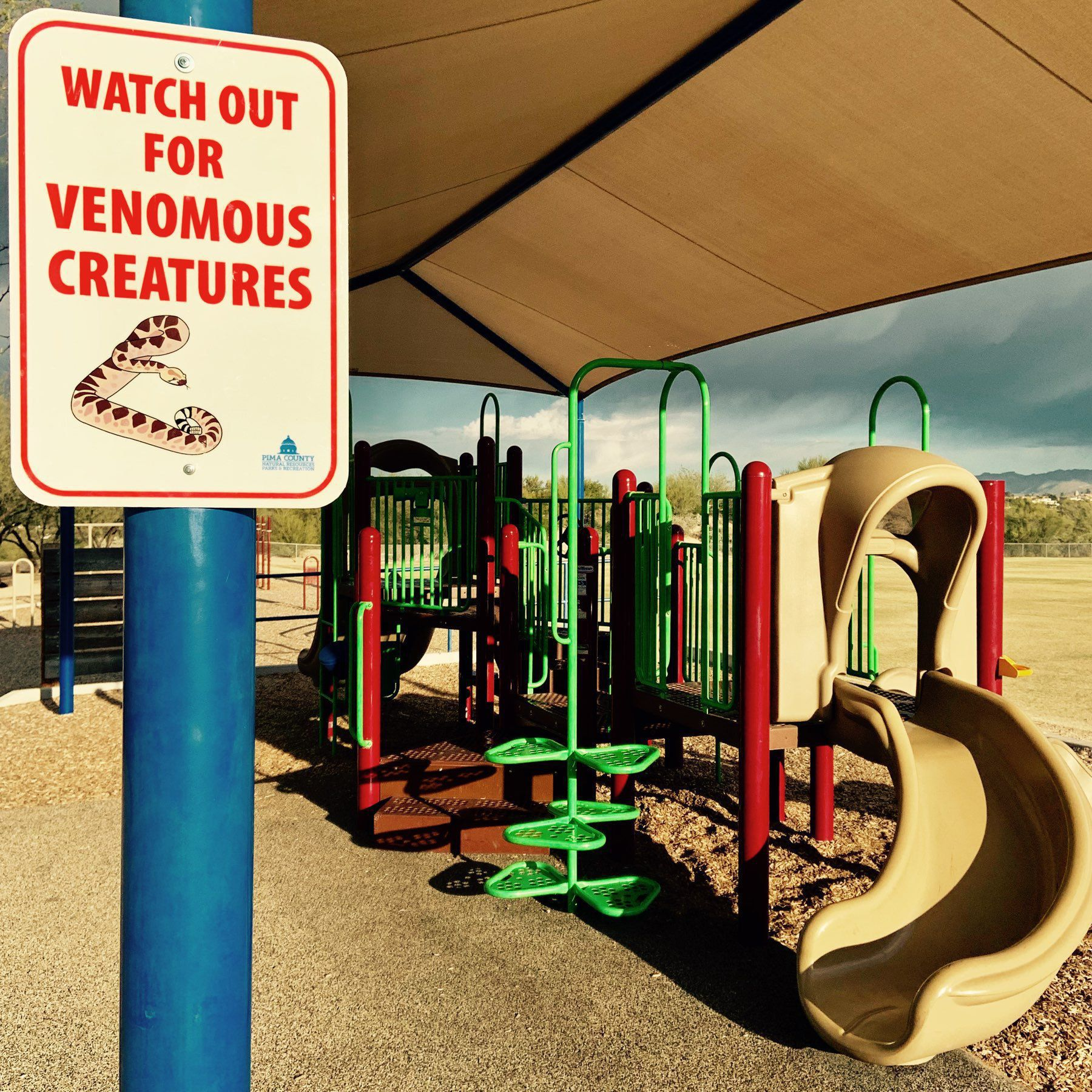 Sign Warning About Venomous Creautures at a Park in Pima County