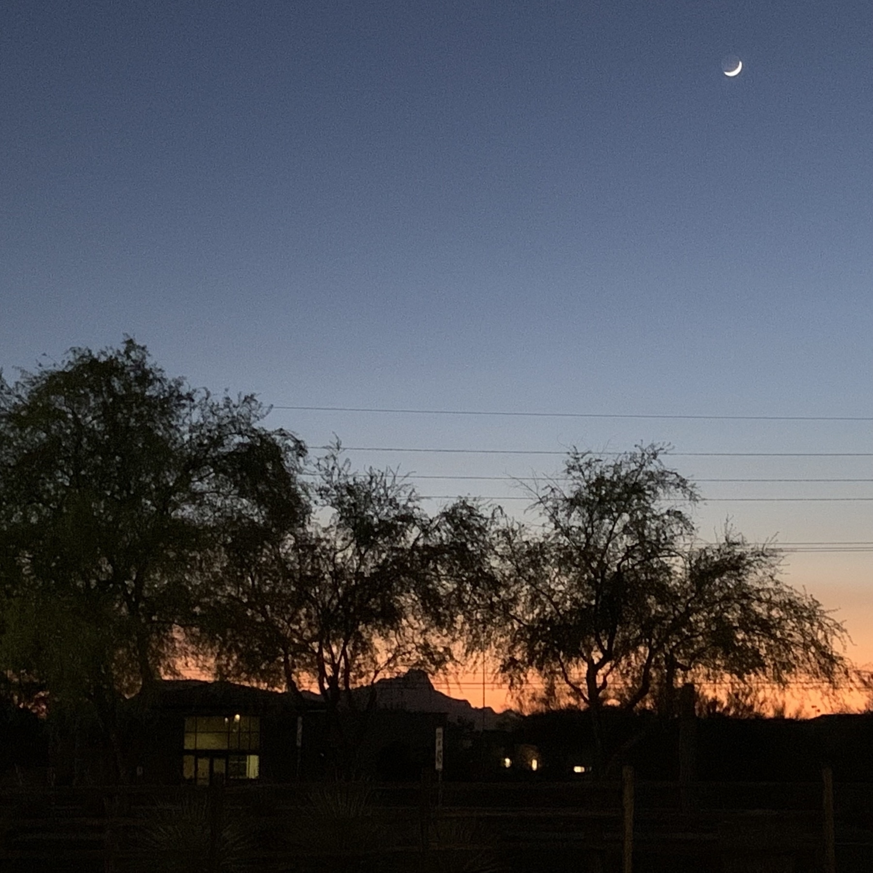 sunset with crescent moon